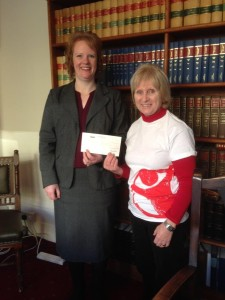 Jennifer Carpenter of Adams Harrison presents cheque to Lynne Taylor of Save the Children