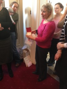 Christina Opens Gift Of Earrings From Her Adams Harrison Colleagues