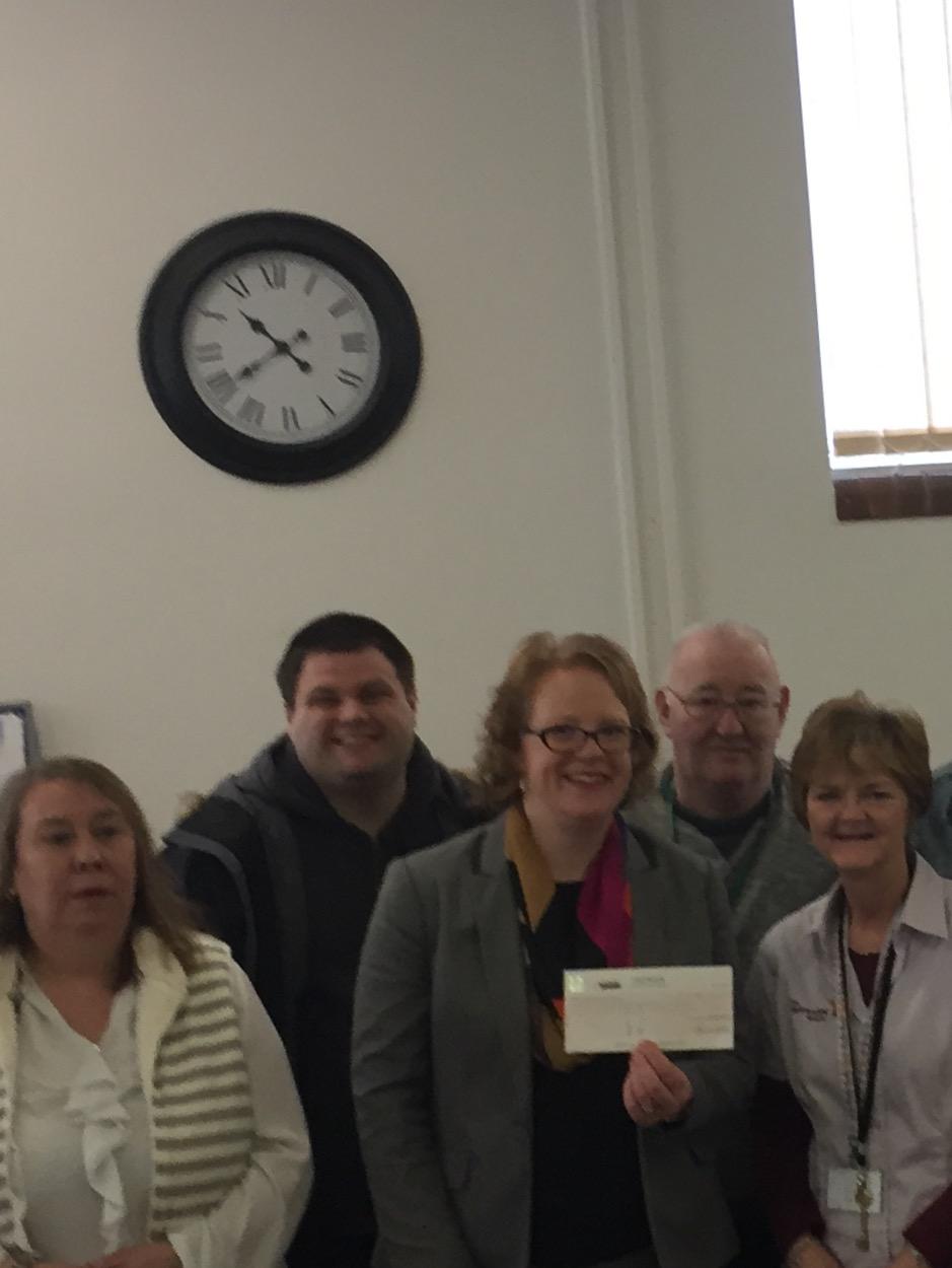 Adams Harrison Present Cheque to The Befriending Scheme Haverhill
