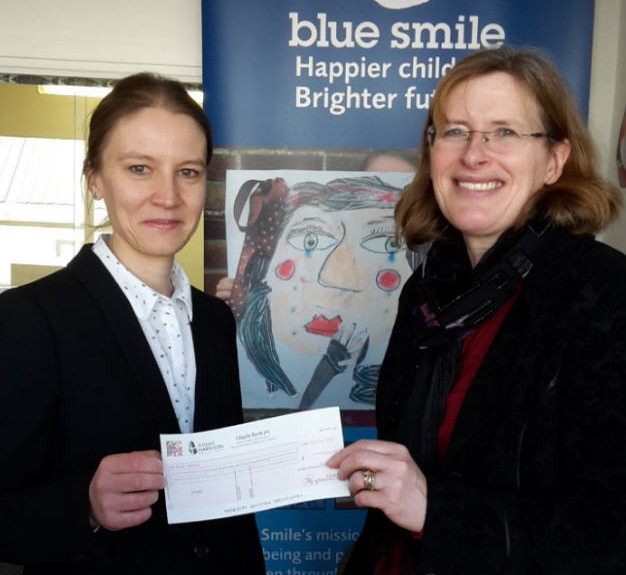 Blue Smile Recieves Cheque From Adams Harrison