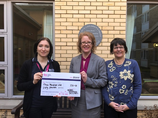 The Sick Children's Trust Recieves Cheque From Adams Harrison
