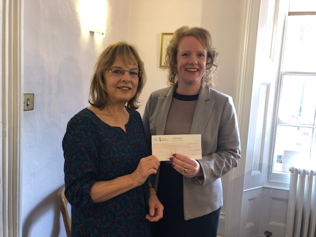 Pamela Jenner Receives Cheque From Jenny Carpenter Of Adams Harrison