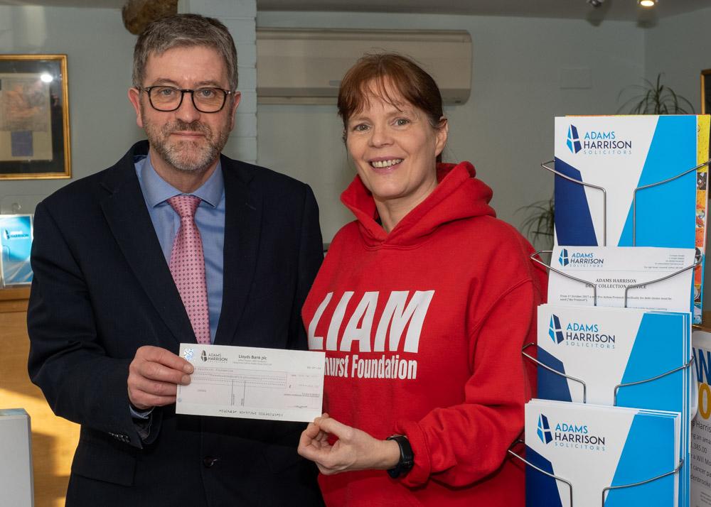 Rhodri Rees presenting a cheque to Sarah Fairhurst